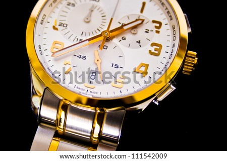 Detail view of luxury swiss watch on a black background
