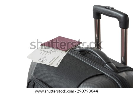 Detail view of Trolley suitcase with passport and flight tickets isolated on white background