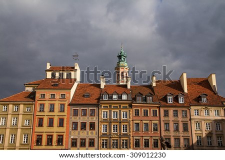 Detail view of Warsaw, Poland historic main square, old town market place, with bronze statue. - stock photo
