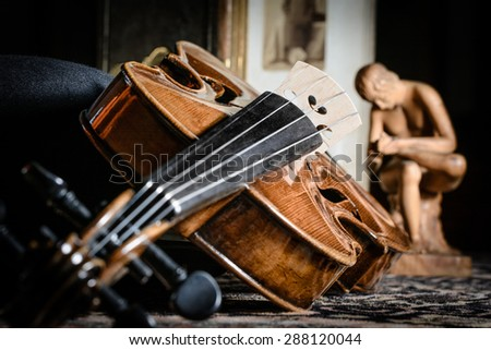detail violin - still life with a wooden figure, color version, due to the character contains grain / noise ratio and enhanced details