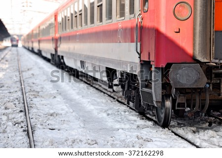Detail with a train wagon in a train station in winter season - stock photo