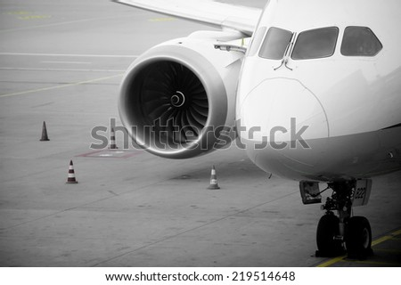 Detail with the front of an airplane parked in the airport - stock photo