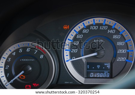 detail with the gauges on the dashboard of a car - stock photo