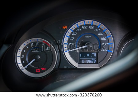 detail with the gauges on the dashboard of a car