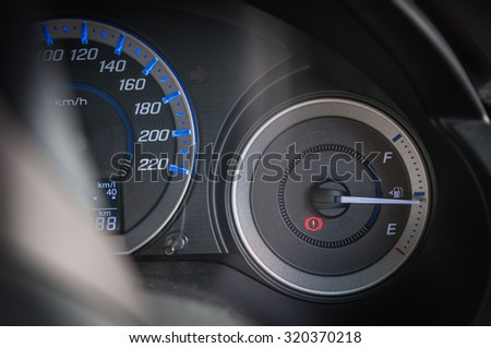 detail with the gauges on the dashboard of a car,fuel gauge - stock photo