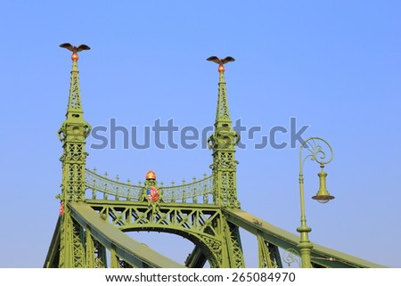 Detail with upper section of a steel bridge painted green, Budapest, Hungary - stock photo