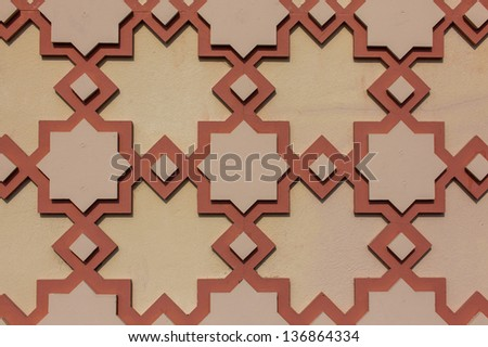 Detailed background of the intricate tile patterns on a wall - stock photo