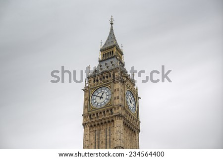 detailed close-up of Elizabeth Tower (Big Ben Clocktower) in front of gray cloudy sky,  London, United Kingdom, Europe - stock photo