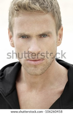 Detailed close up portrait of a young blond man - stock photo