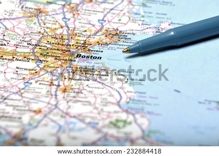 Detailed closeup map of Boston and pen pointing to destination for travel - stock photo
