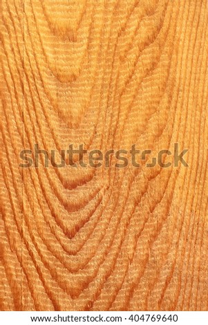 Detailed coarse structure of longitudinal section of wooden board with annual rings