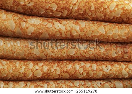 detailed folded crepes or blinis background - stock photo