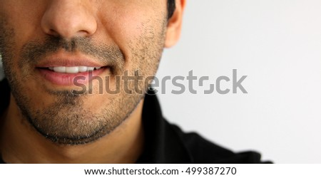 Detailed image of young man smiling with white teeth
