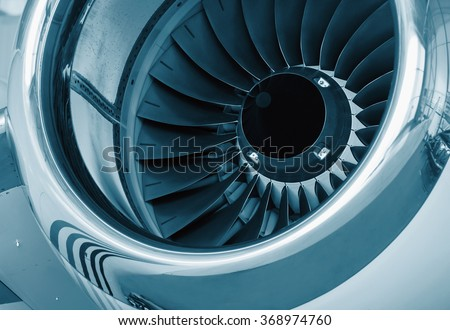 detailed insigh tturbine blades of an aircraft jet engine, colored technical blue - stock photo