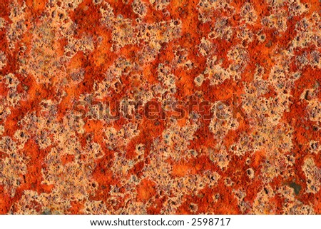 Detailed macro shot of a patch of rust, strong colours and interesting textures. - stock photo