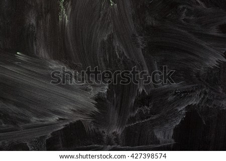detailed macro shot of some dirty blackboard - stock photo