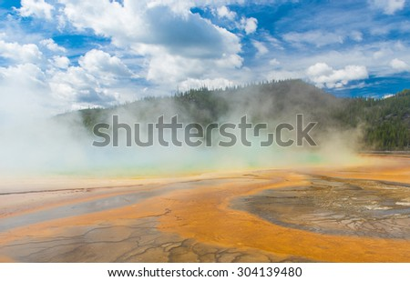 Detailed photo of steaming Grand Prismatic Spring. Yellowstone National Park, Wyoming, USA - stock photo