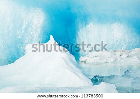 Detailed photo of the Icelandic glacier iceberg in a ice lagoon with incredibly vivid colors and a nice texture - stock photo