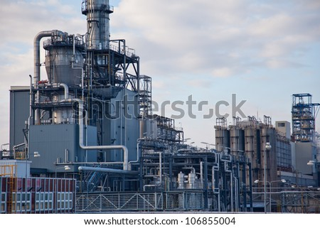 Detailed piping and tanks of distillation unit - stock photo