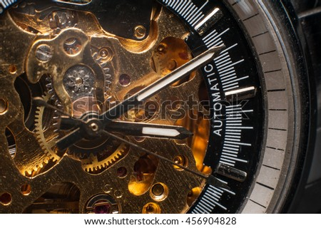 Detailed shot of a vintage watch or old watch. - stock photo