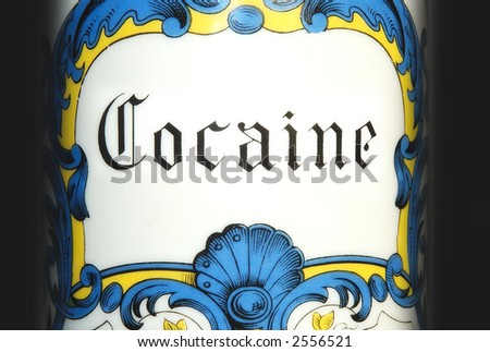 Detailed shot of an antique cocaine jar on black background. - stock photo