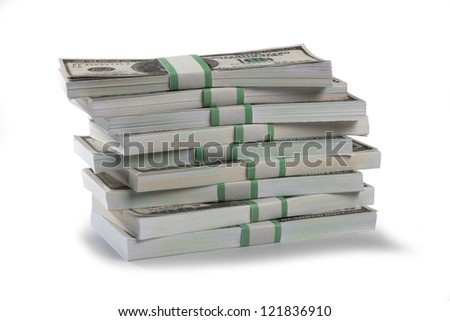 Detailed shot of stacks of US dollars bundle on white background. - stock photo