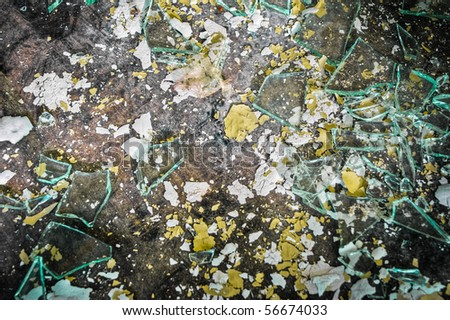 Detailed texture with chipped paint and broken glass on a stained, dirty floor.