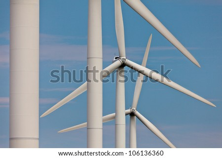 Detailed view of a row of wind turbines - stock photo