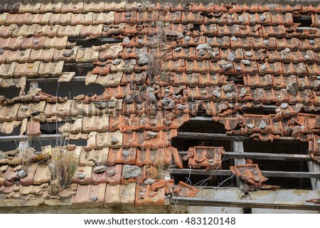 Detailed view of abandoned building with damaged tile roof
