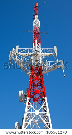 detailed view of communication tower over blue sky