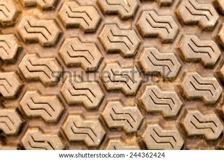 Detailed view of heavy tractor tire tread texture  - stock photo