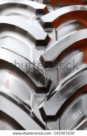Detailed view of heavy vehicle rubber tire tread texture of a new tractor or other construction machinery