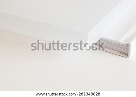 Detailed view of white photo books resting on table - stock photo