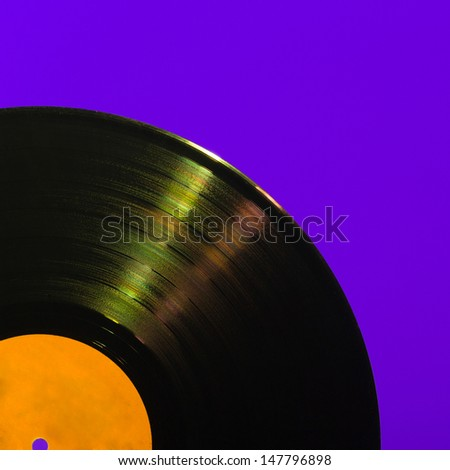 Detailed vinyl LP close up background with shallow depth of field
