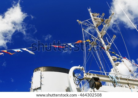 Details deck of the ship. The mast of the ship and signal flags.