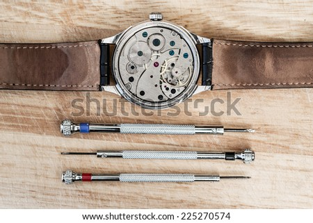 Details for repair of clocks - stock photo