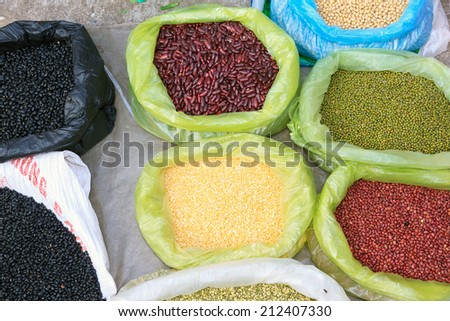 Details from a street market scene in Namdinh, Vietnam, plastic bag filled with dried beans and pulses. - stock photo