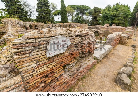 Details in the old town of Ostia, Rome, Italy. Ruins of an ancient roman cemetery (tombs alley signpost), heritage of early italian history, now travel destination for tourists. - stock photo