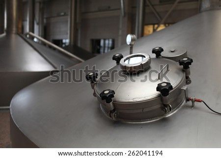 Details manhole of fermentation vat in the modern brewery - stock photo
