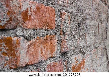 Details of a brick wall and concrete unfinished. - stock photo
