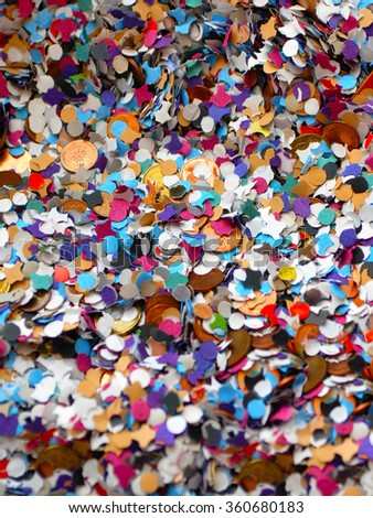 Details of a color full carnival confetti background with money inside