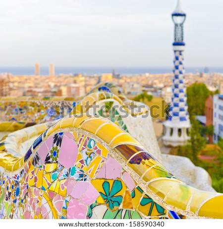 Details of a colorful ceramic bench in Parc Guell designed by Antoni Gaudi, Barcelona, Spain.  - stock photo