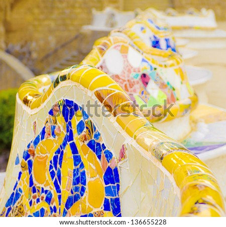Details of a colorful ceramic benches at Parc Guell designed by Antoni Gaudi, Barcelona, Spain. - stock photo