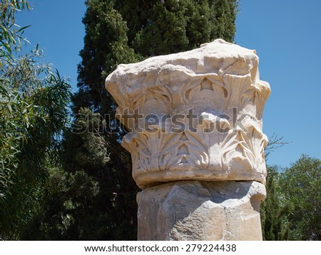 Details of a Corinthian Greek Ionic Roman Classical Marble Column with sky background - stock photo