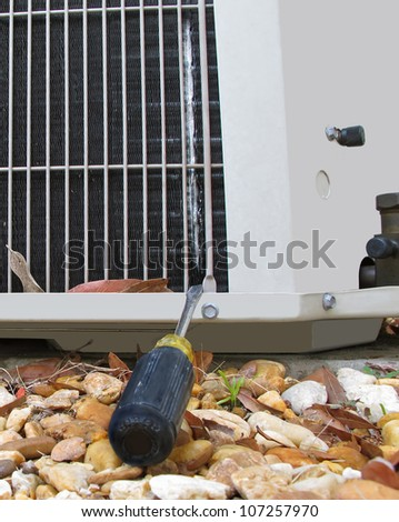 Details of a damaged air conditioner showing significant signs of wear with a coil leaking freon.