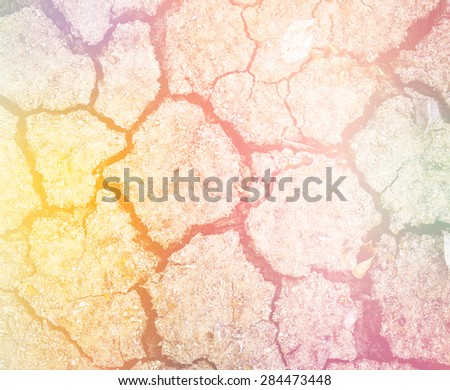 Details of a dried cracked earth soil made with color filters. - stock photo