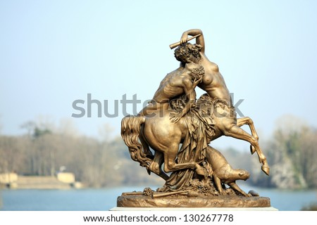 "Details of a famous statue from the ""parc de la tete d'or"" at Lyon. It is a beautiful bronze statue made by Augustin Courtet in 1849. - stock photo"