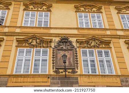 Details of a historic building on Lesser town square (malostranske namesti) in Prague, Czech Republic - stock photo