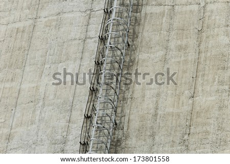 Details of a huge cooling towers with ladder of a power plant - stock photo