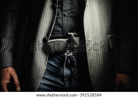 Details of a man with pistol, conceptual composition about having a gun.  - stock photo